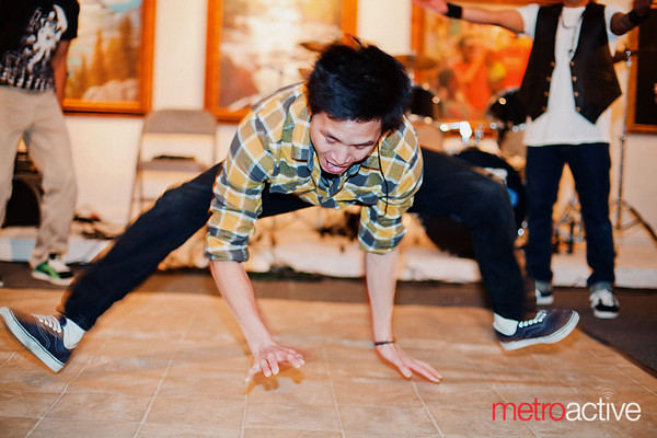 Richard Tran, a member of Above As One, shows of his wild style.