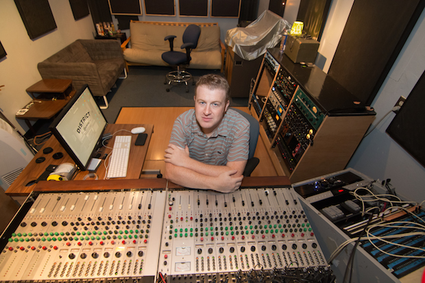 Ryan Perras behind the soundboard at District Recordings in San Jose. Photo by Geoffrey Smith II.