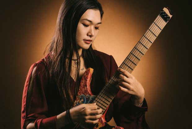 TAP IT IN: Playing the guitar like a piano, Yvette Young can play chords, basslines and melody simultaneously.