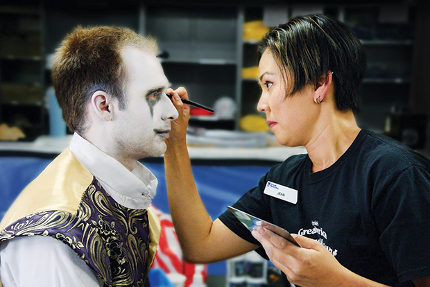 Brian Miller gets into character with the help of makeup artist Jenn Majdi. Photo by Greg Ramar.